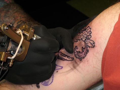 Mike tattoing josh.