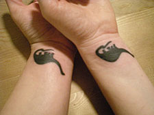 Brontosaurus tattoos from eggandtoast\'s flickr photostream.