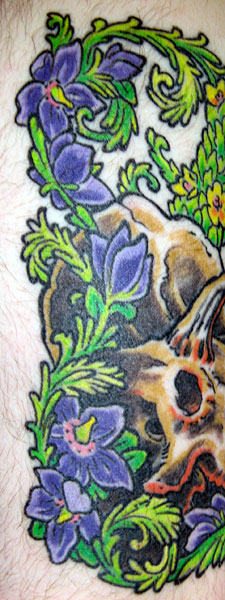 Flowers from triceratops tattoo by Mike Bellamy of Red Rocket Tattoo