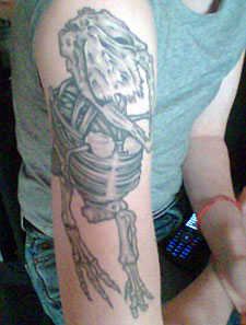 Dinosaur tattoo by Shotsie Gorman