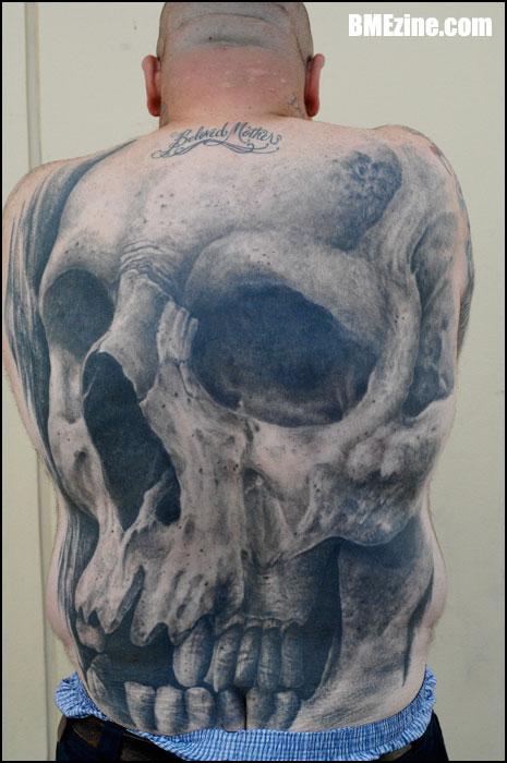 big skull tattoo at back body